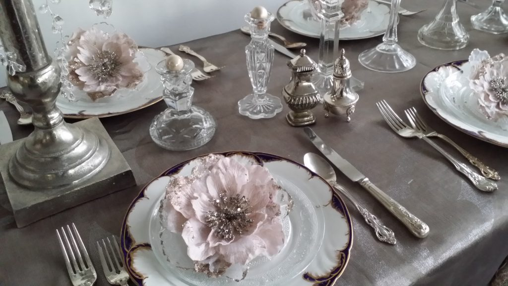 vintage cutlery hire with glass candlesticks as winter wedding idea