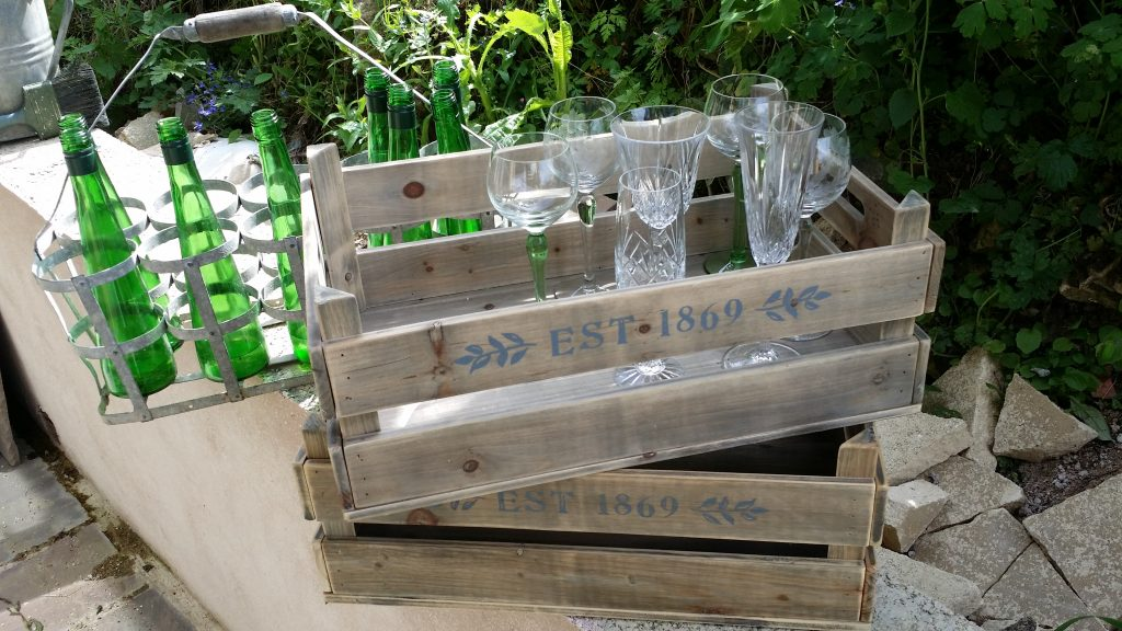 green stemmed glasses for wow woodland weddings in hire crates