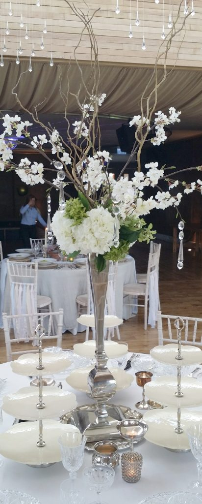 Hire tall wedding table centre decorations and Gatsby 3 tier cake stands, here at Elmore Court