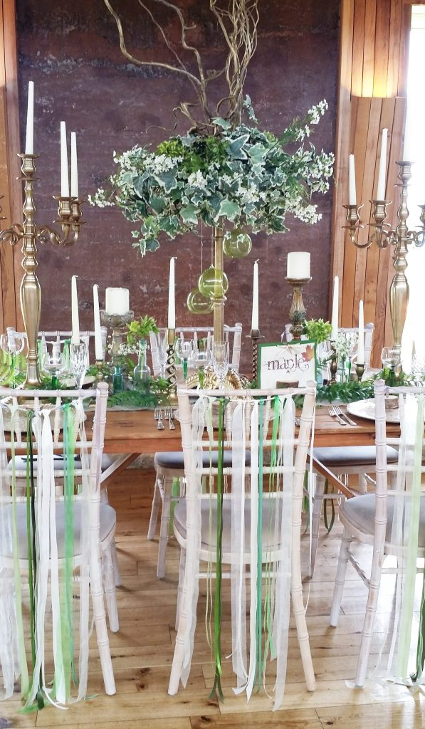 woodland wedding dressed table decor woth gold candelabras at Elmore Court