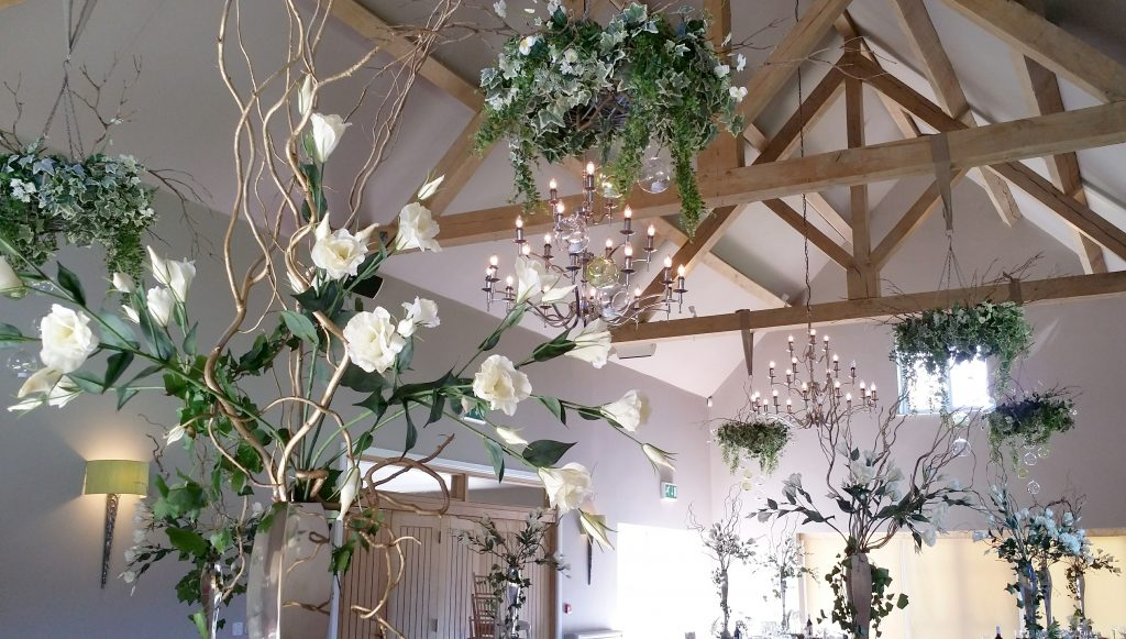woodland decor of hanging wreaths & tables centres for Hire, pictured at Hyde Barn