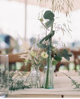 aqua green glass bottles at Marquee wedding
