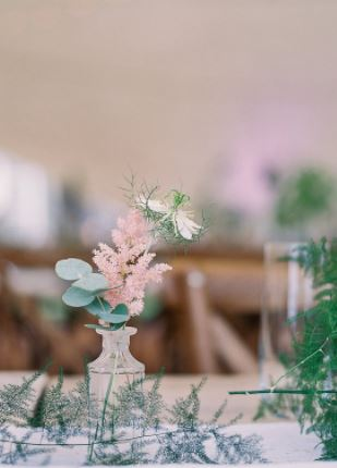 aqua green & clear glass bottles at Lucy's marquee wedding