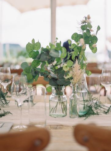 aqua green & clear glass bottles detail at marquee wedding