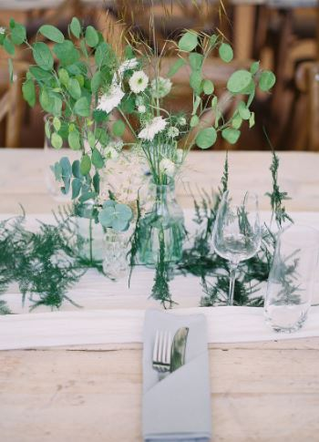 aqua green & clear glass bottles decor to hire, place setting in marquee
