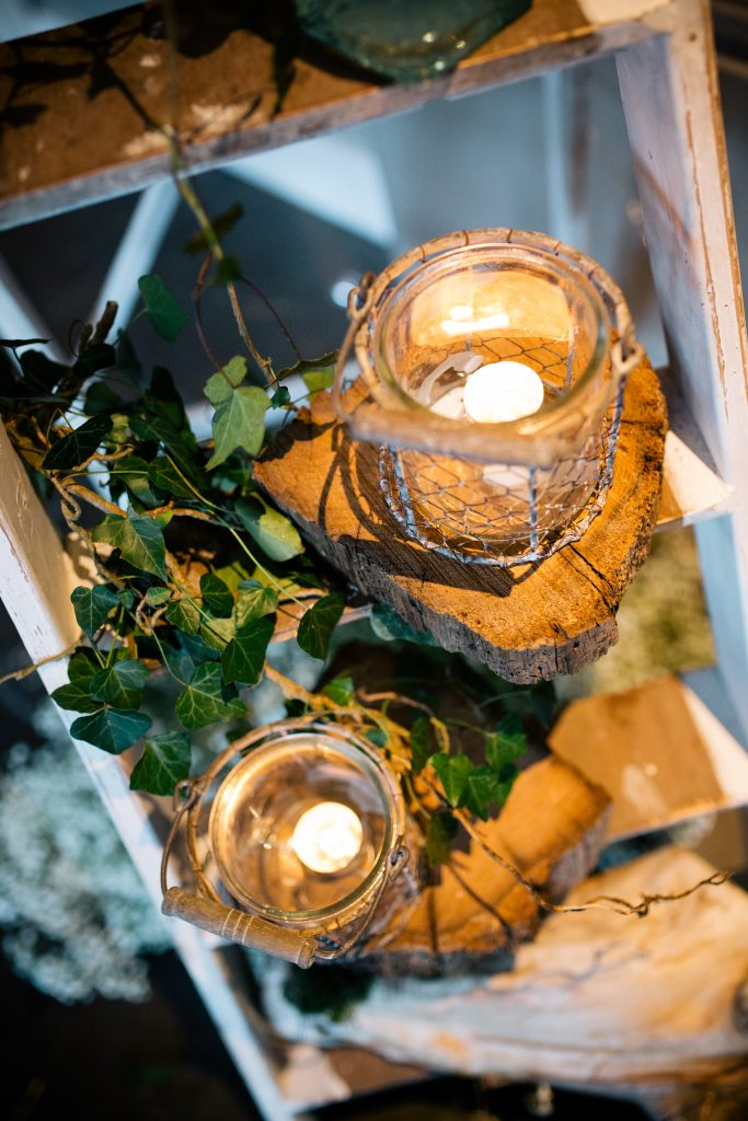 Hired woodland wedding tealight holders at Hyde barn