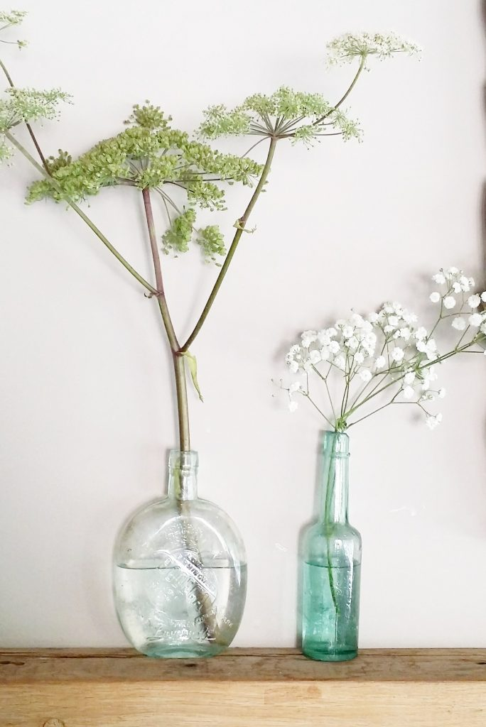 hire of mixed aqua green bottles for woodland wedding flowers