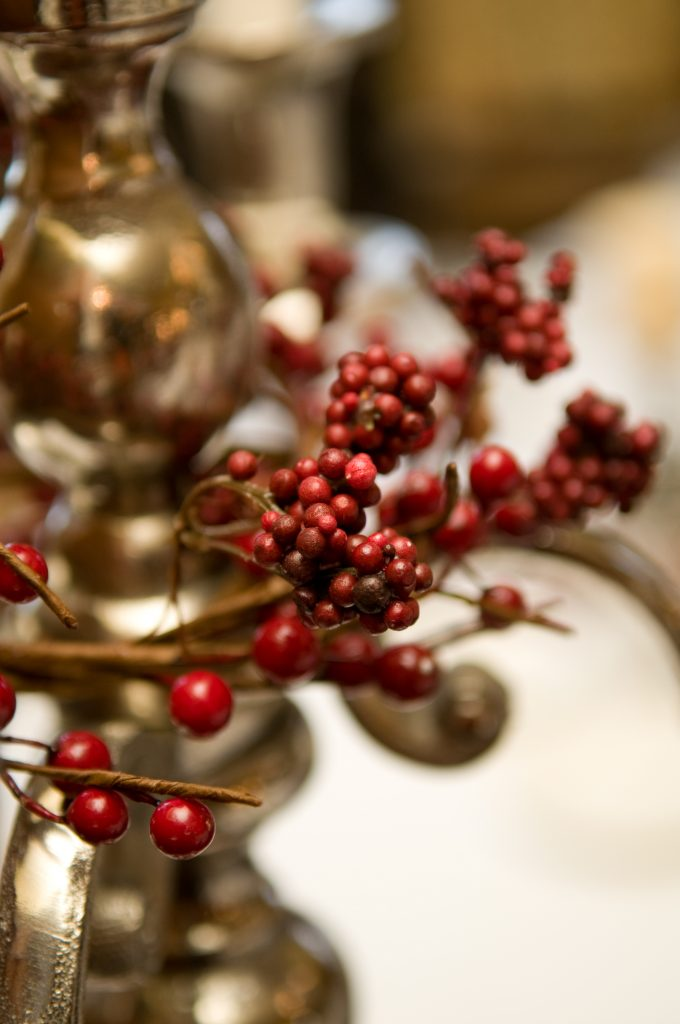 hire winter berry wreaths to dress candelabras for wedding table centres