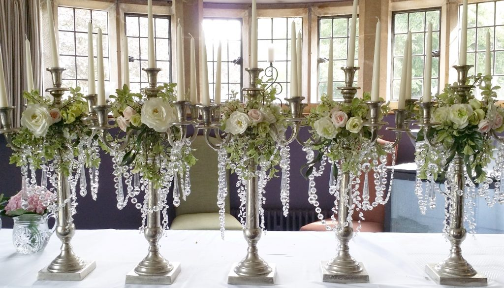 dressed tall candelabras, fake & fresh flowers at the Bear of Rodborough in the Cotswolds