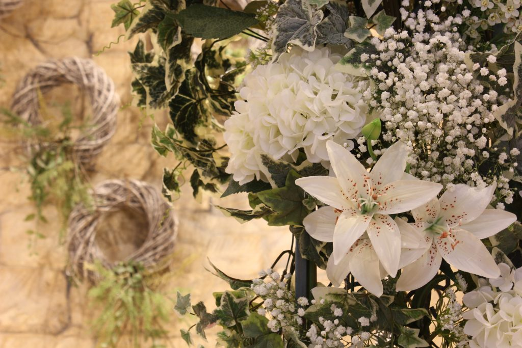 ceromony & wedding arch flower detail, Great Tythe barn Tetbury