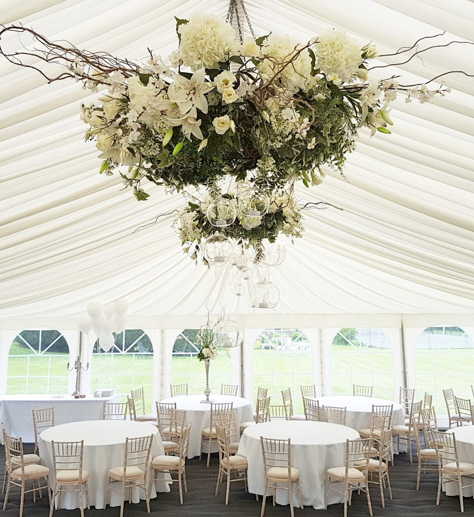 hire white flower hanging wreath for a marquee or barn style wedding