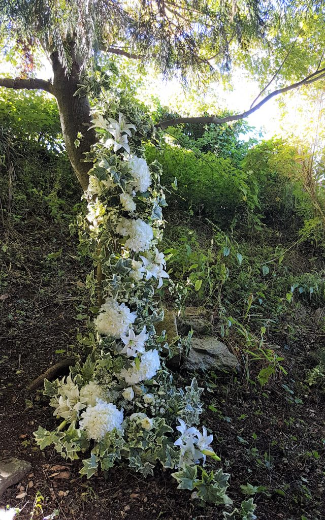 wedding garland as tree decoration for summer weddings in the Cotswolds