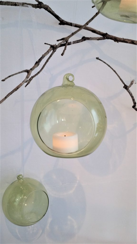 clear or green glass baubles with tea lights to hire for woodland wedding