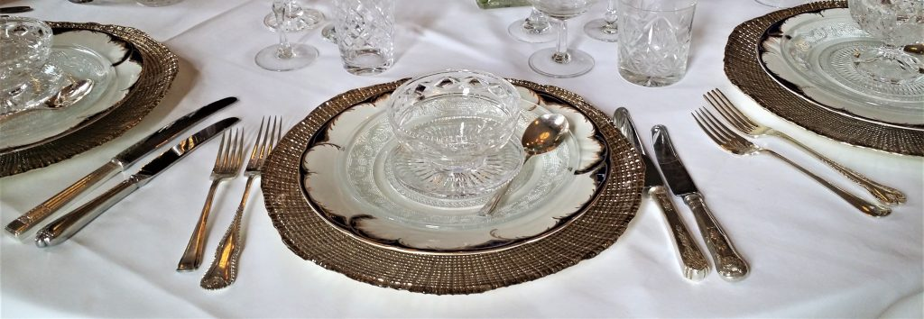 Hire vintage cutlery, gold charger plates, vintage glasses for wedding at Cowley Manor