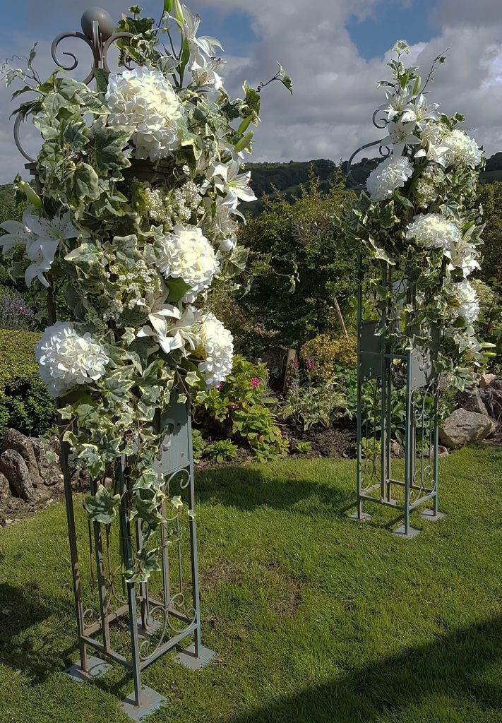 wedding gate pillars with flowers to hire for summer weddings