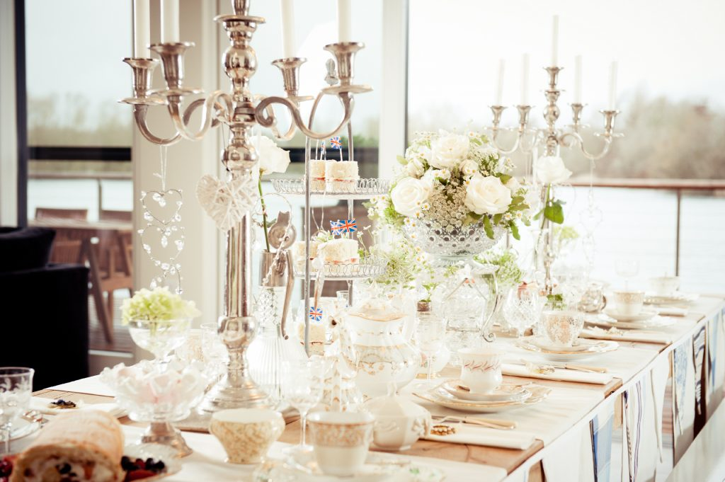 vintage white table with tall silver candelabras to hire, seen at the Lakes by Yoo