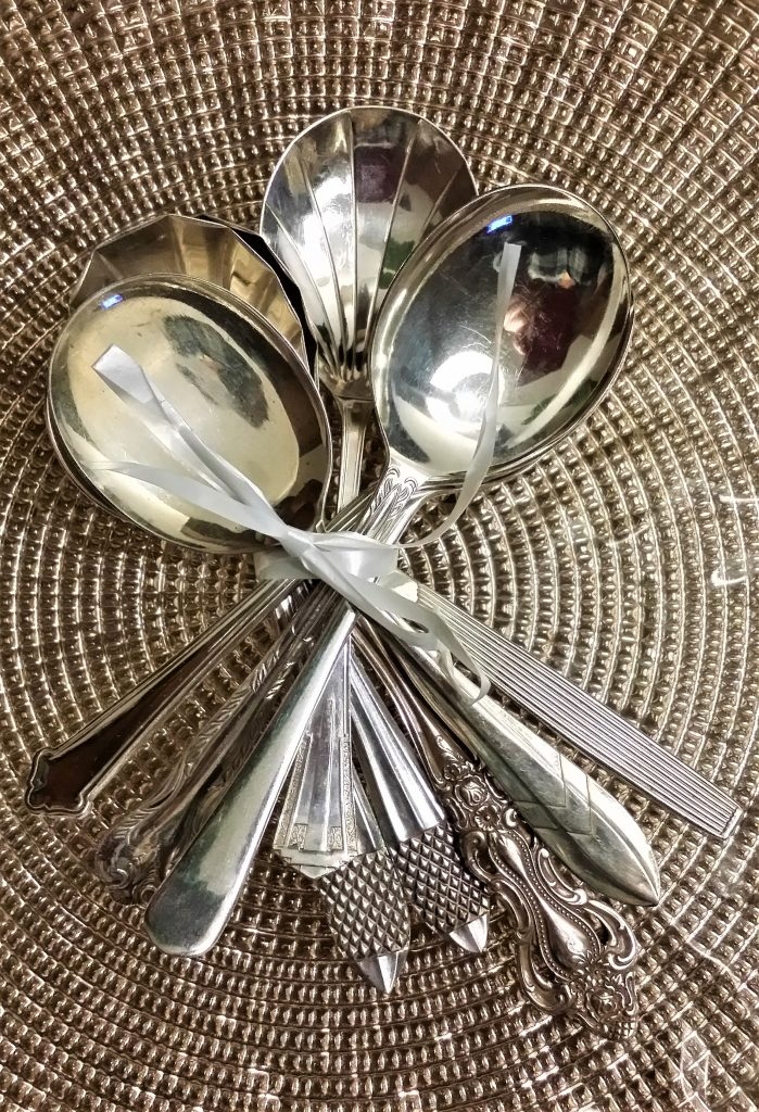 Hire vintage cutlery fruit salad spoons on gold charger plate