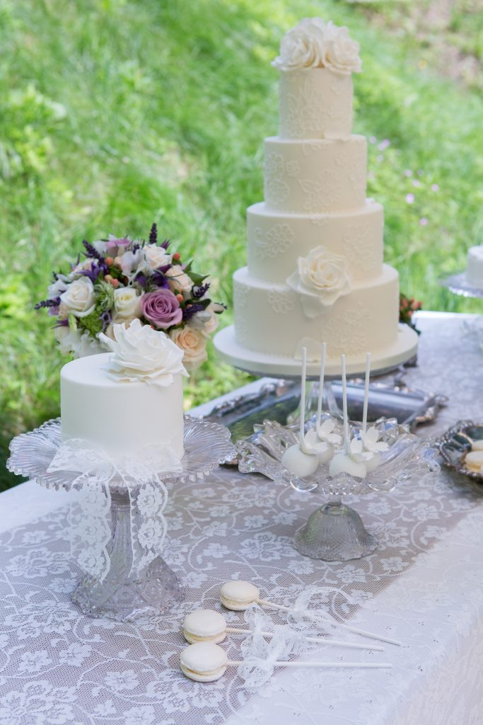 Hire glass pedestal wedding cake stands for summer weddings