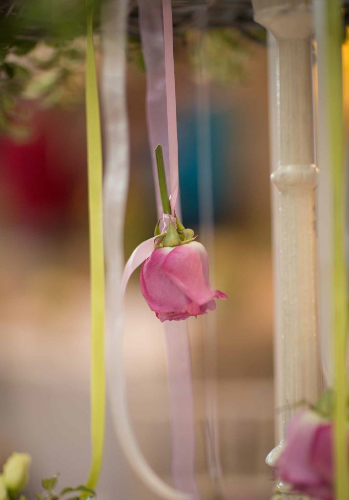 hanging flowers on ribbons for wedding ceremony aisle back drop