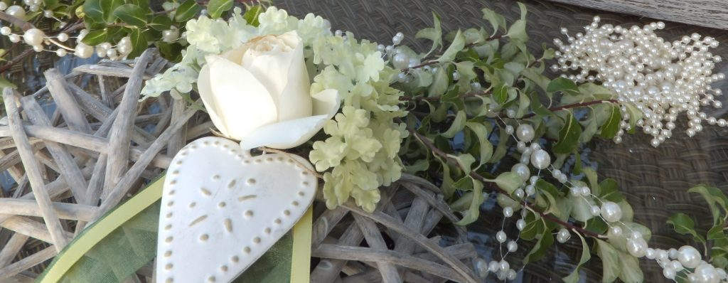 roses & pearls for wedding hire with fresh foliage added