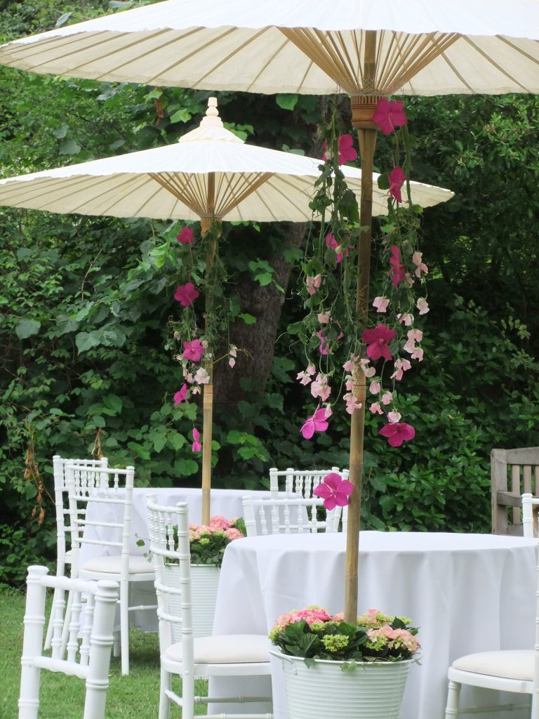 bamboo parasols for summer wedding hire with flowers