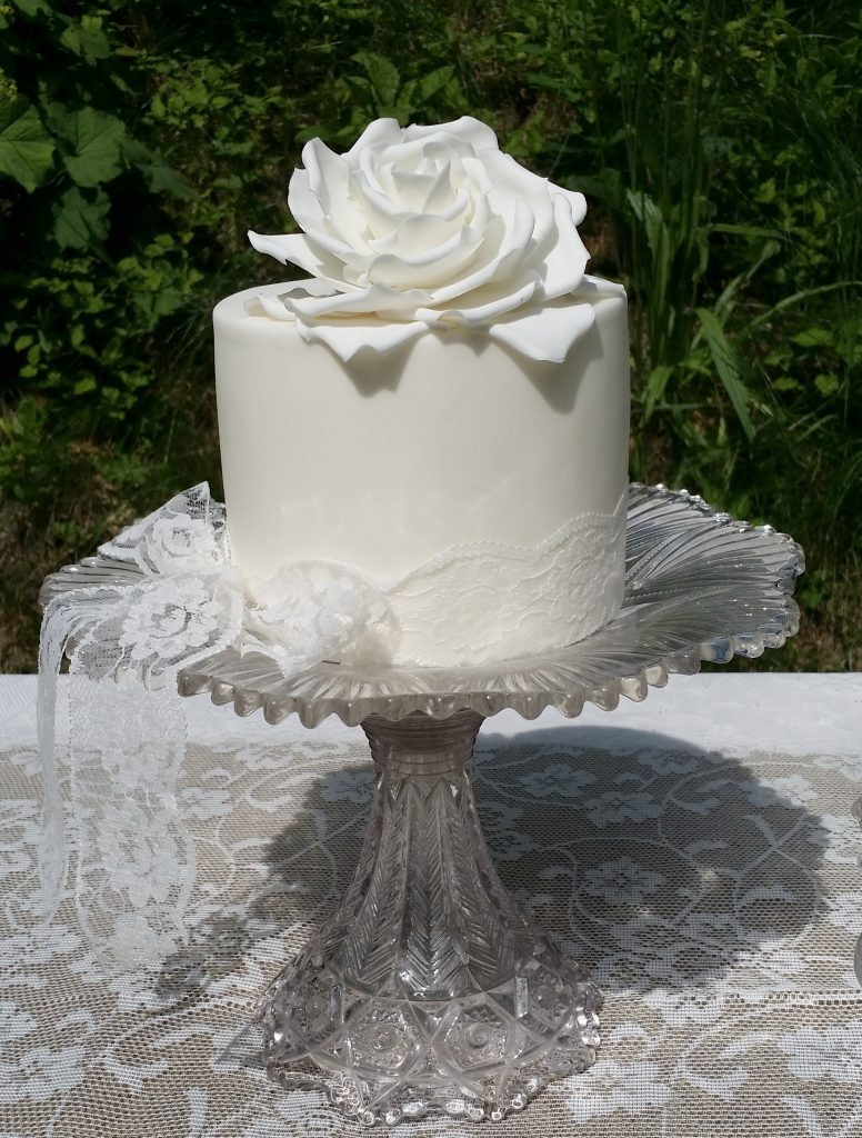 pedestal glass cake stand for lacy white weddings