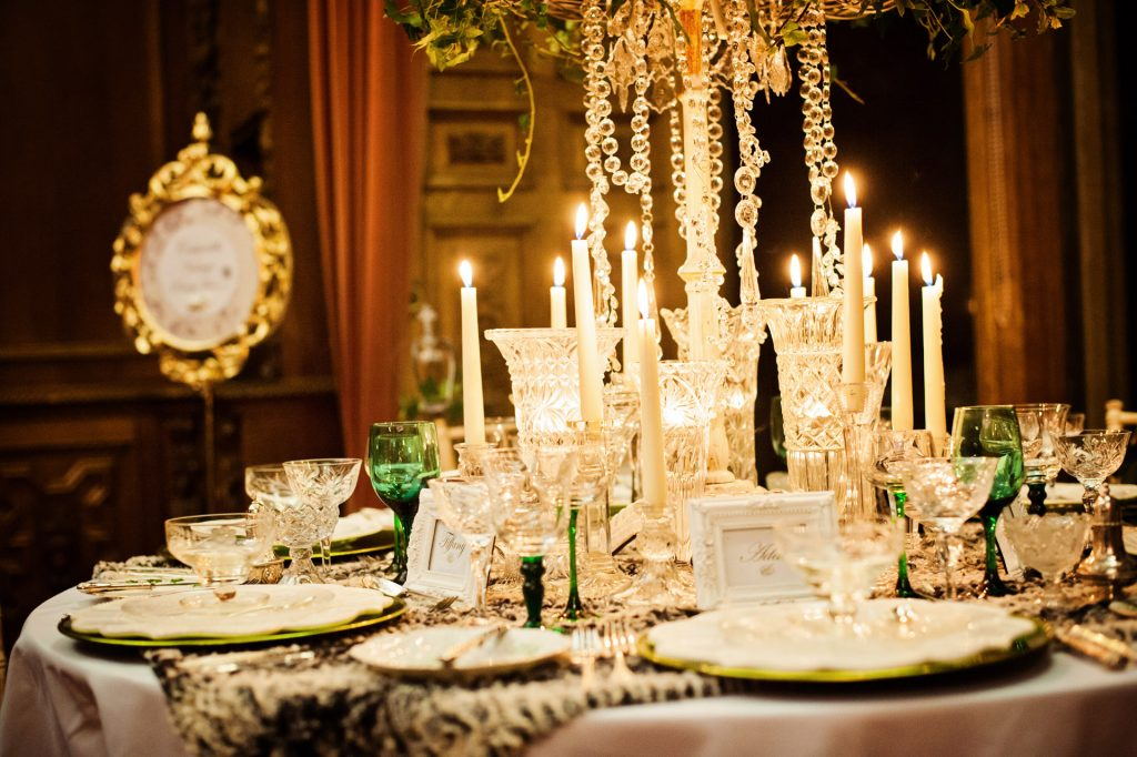Hire vintage vases, green glasses, vintage cutlery glass candlesticks and luxury table centres for a winter wedding at the Manor by the Lake