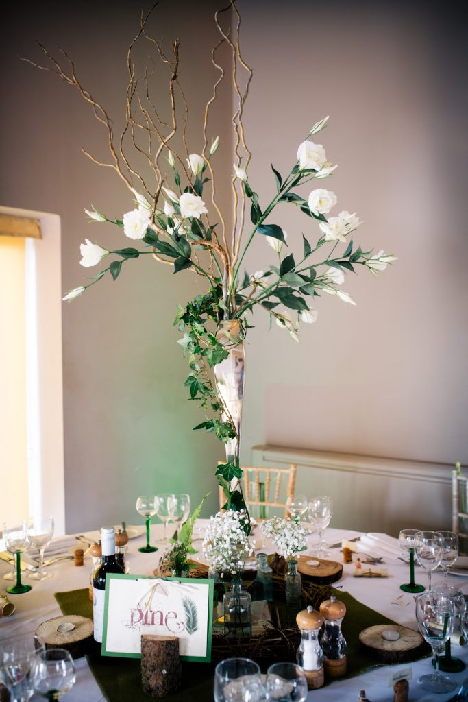 tall wedding table centre decor with lisianthus at Hyde barn in the Cotswolds