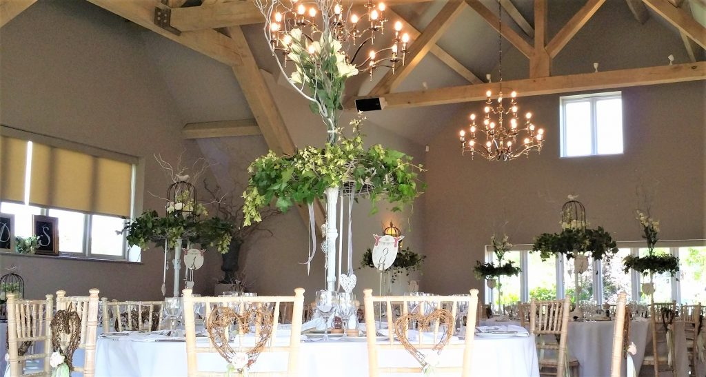tall table centres hired to a Hyde Barn wedding