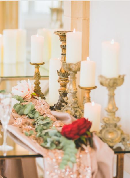 Hire gold rococo candlesticks for luxury gold weddings
