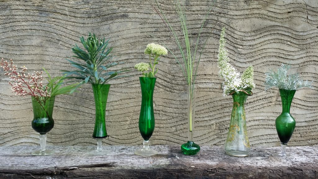 diy wedding table centre idea of vinatge coloured vases