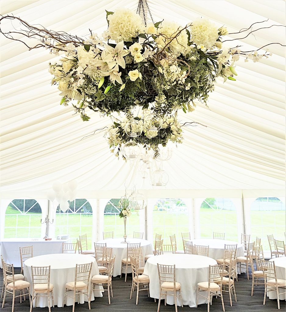 Hire white flower hanging wreaths for marquee & barn wedding venue decoration