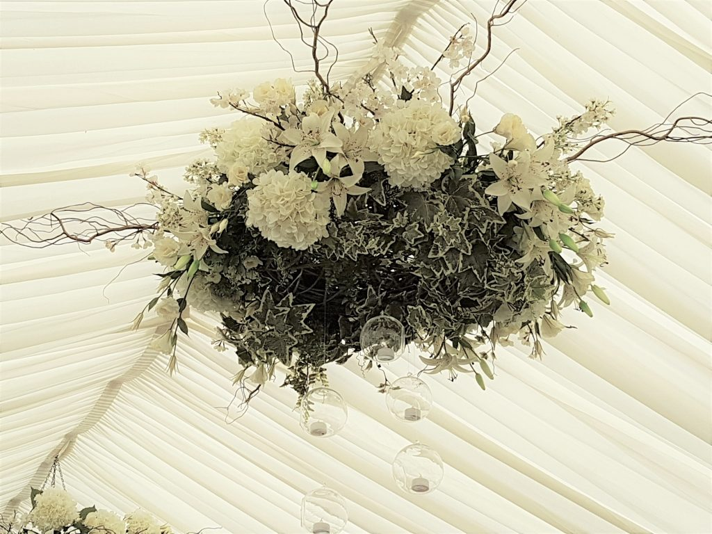 large hanging white wreath to hire for marquee & barn weddings in the Cotswolds