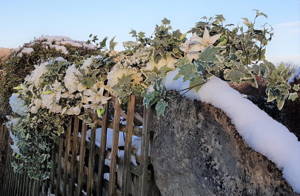winter flower garland to hire for wedding top table, staircase flowers, or part of a floral wedding arch