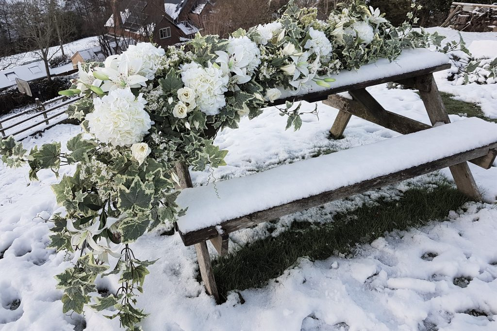 Hire winter white flower garland to dress wedding top table