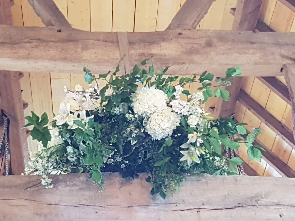 woodland wedding hanging wreath to hire here at Hanley Barn wedding venue