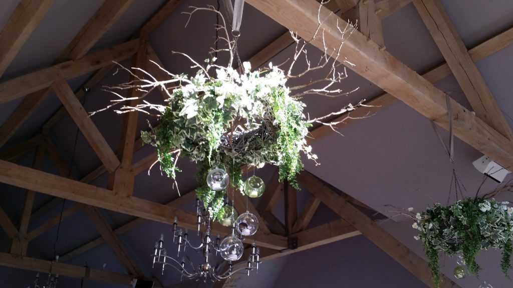 woodland wedding hanging wreath to hire here at Hyde Barn wedding venue