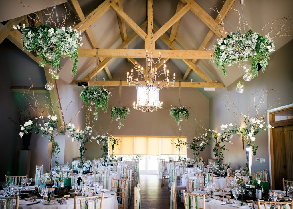 woodland wedding hanging wreaths & tall table centres ,all for hire , here at a wedding in Hyde Barn